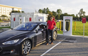 Tesla owner charging up his car.