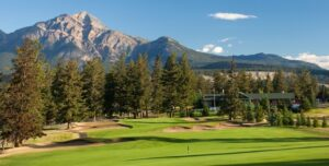 The par-4 closing hole at the Fairmont Jasper Park Lodge GC careens down the hill and features Pyramid Mountain in the background.