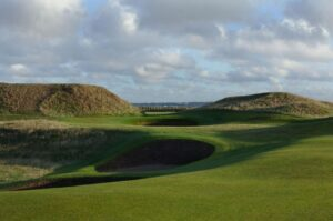 The 5th green at Royal St George's through the dunes