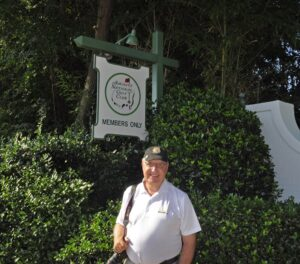 Standing infront of the Augusta National Golf Club sign